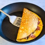 Omelette with cheese, ham and mushrooms